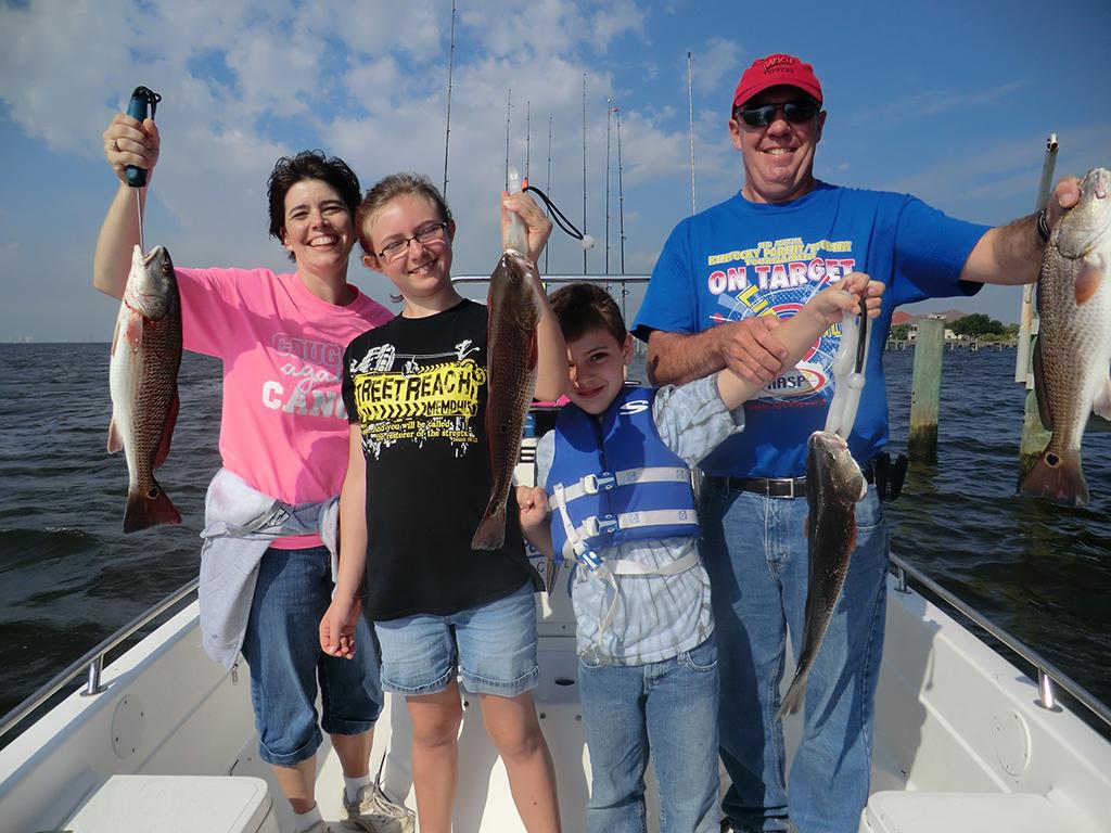 family fishing on navarre charter boat