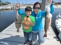 kids fishing on our charter boat