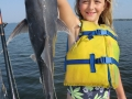 girl catching fish on charter